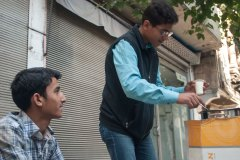 Mahmoud, 16, left and his friend, also named Mahmoud, 15, sell sahlab on the streets in Kilis, Turkey.